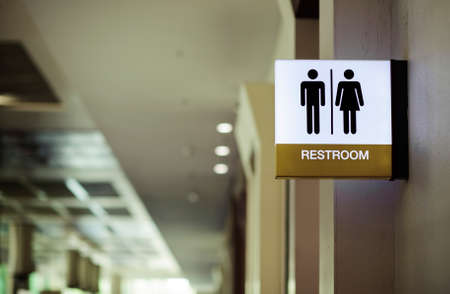 Public restroom signs at the entrance in the meeting room