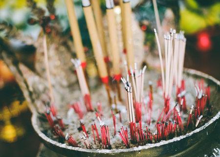 Incense sticks on fire smoke