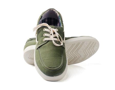 Green fashion canvas shoes on white Фото со стока