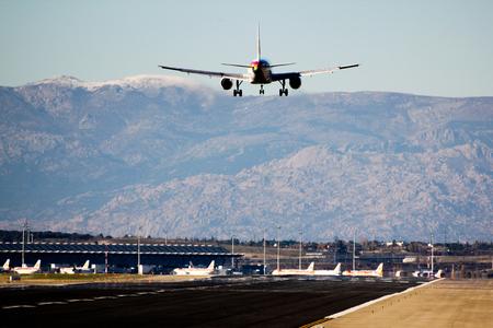 barajas: MADRID, SPAIN - November 27, 2011 - Iberia plane landing at the airport of Madrid Barajas.