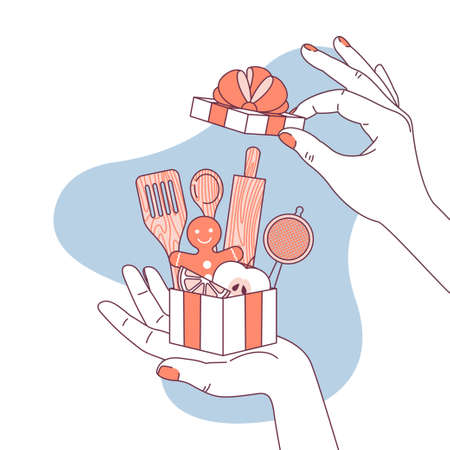 Woman hand holding a gift for cooking lover. Kitchen utensils.