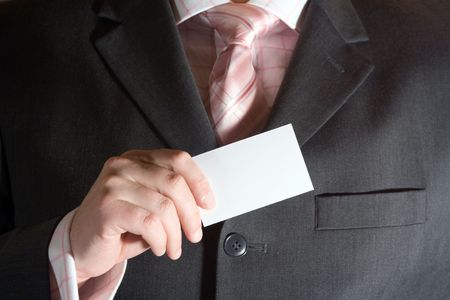 suit  cuff: A businessman holding a blank business card
