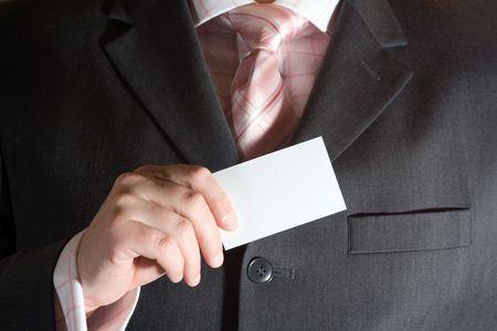 A businessman holding a blank business card