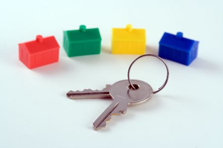 derivative: House keys in front of a row of plastic houses
