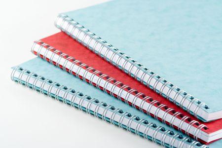 Three spiral bound notepads photo