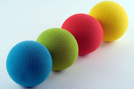 Blue, green, red and yellow sponge balls photo