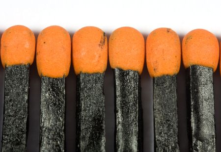 A line of black matches against white background