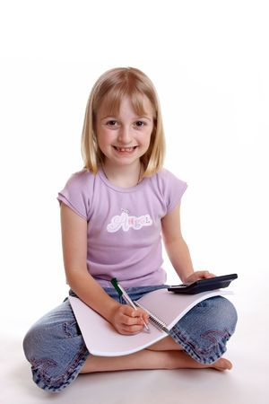 schoolwork: A young girl sat doing her schoolwork Stock Photo