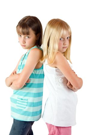 Two sisters back to back in a bad mood with each other Stock Photo