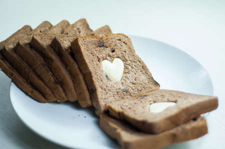 nuances: photo love bread. bread valentine. photo love delicious slice of bread with strawberry jam sweetener. is suitable for decorating the nuances of affection