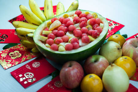 various fruits in chinese new year, orange, watermelon, apples, pears and bananas