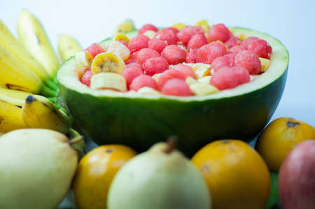 apples and oranges: salad variety of fruit is good for health, red watermelon, apples, oranges and pears