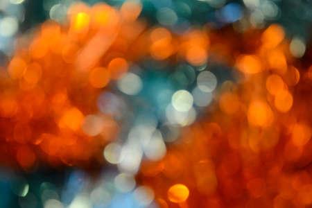 Bokeh. Holiday background. Christmas lights. Glitter. Defocused sparkles. New Year backdrop. Festive wallpaper. Blinks. Carnival. Bokeh retro style photo. Orange. Banque d'images