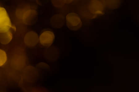 Bokeh. Holiday background. Christmas lights. Glitter. Defocused sparkles. New Year backdrop. Festive wallpaper. Blinks. Carnival. Tinsel. Bokeh retro style photo. Golden. Gold. Фото со стока - 150295854