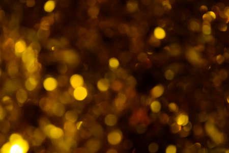 Bokeh. Holiday background. Christmas lights. Glitter. Defocused sparkles. New Year backdrop. Festive wallpaper. Blinks. Carnival. Tinsel. Bokeh retro style photo. Golden. Gold. Banque d'images