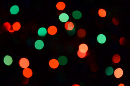 Bokeh. Christmas lights. Holiday background. Garland. Glitter. Defocused sparkles. Festive. New Year backdrop. Blinks. Carnival. Bokeh retro style photo. Multicolor. Colorful. Фото со стока - 150469432