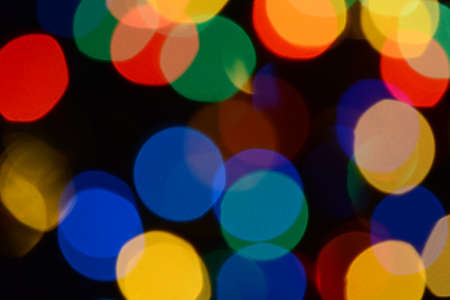 Bokeh. Christmas lights. Holiday background. Garland. Glitter. Defocused sparkles. Festive. New Year backdrop. Blinks. Carnival. Bokeh retro style photo. Multicolor. Colorful.
