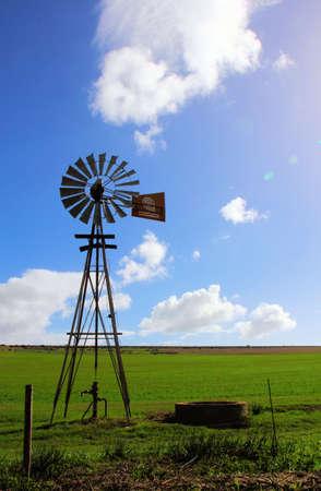 Windmill against sun  4  Stock Photo