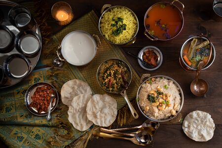 South Indian vegetarian food served in  traditional copper servingware Stock Photo
