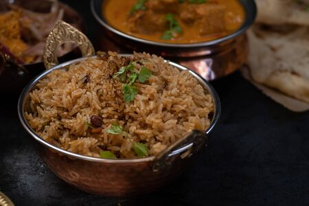 Indian tamarind rice in copper bowl