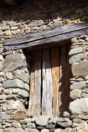 Boarded window of a rural stone house Stock fotó
