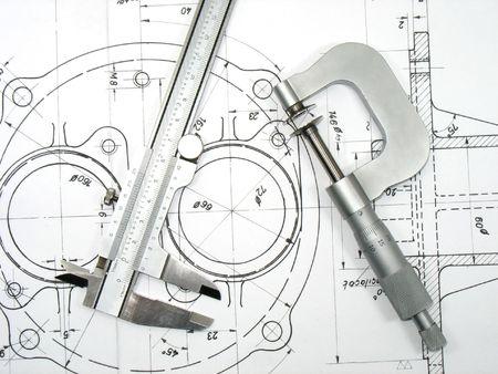 herramientas de mec�nica: Micr�metro de pinza y dibujos t�cnicos. Herramientas de ingenier�a en la serie de dibujos t�cnicos