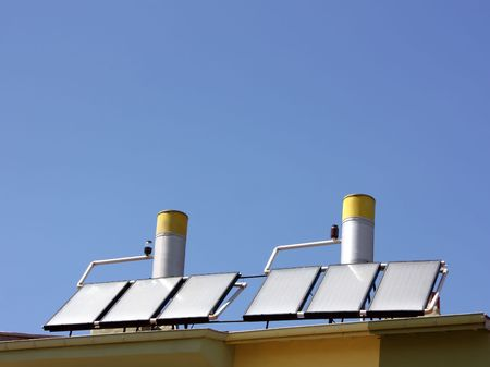 Solar water heating panels on a house roof Stock Photo