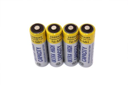 nimh: Four rechargable batteries isolated on white background All copyrighted elements removed. Stock Photo