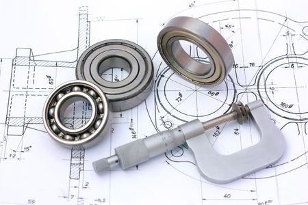 micrometer: Ball bearings with micrometer on technical drawing