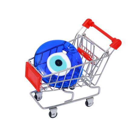 Evil eye bead in shopping cart isolated on white background photo