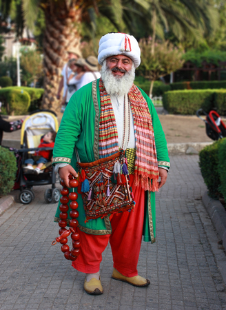 19: KOCAELI, TURKEY - SEPTEMBER 19: Unidentified man in Nasreddin Hodja costume September 19, 2010 in Istanbul, Turkey.  Including clippin path. Nasreddin is a satirical Sufi figure, sometimes believed to have lived during the Middle Ages (around 13th century Editorial