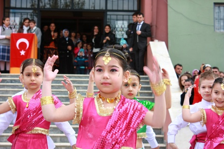 KOCAELI, TURKEY - APRIL 23: Unidentified children students dancing in Indian costumes for 23 April Children Festival April 23, 2011 in Darica, Kocaeli, Turkey. April 23 was proclaimed a national holiday in 1921. The founder of The Republic of Turkey, Atat Editorial