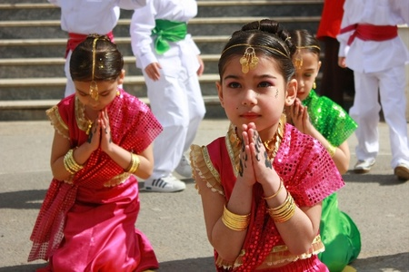 proclaimed: KOCAELI, TURKEY - APRIL 23: Unidentified children students dancing in Indian costumes for 23 April Children Festival April 23, 2011 in Darica, Kocaeli, Turkey. April 23 was proclaimed a national holiday in 1921. The founder of The Republic of Turkey,  Ata Editorial