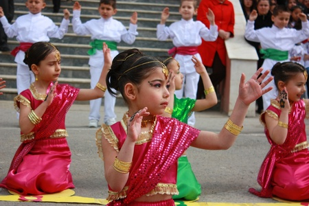 KOCAELI, TURKEY - APRIL 23: Unidentified children students dancing in Indian costumes for 23 April Children Festival April 23, 2011 in Darica, Kocaeli, Turkey. April 23 was proclaimed a national holiday in 1921. The founder of The Republic of Turkey,  Ata Stock Photo - 13161656