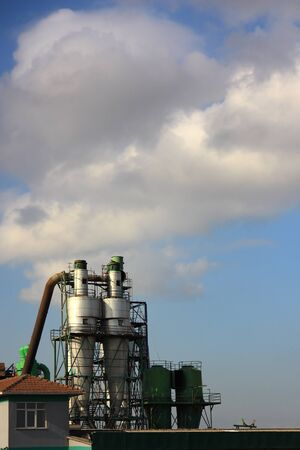 industrie: Two factory chimney over coudy sky