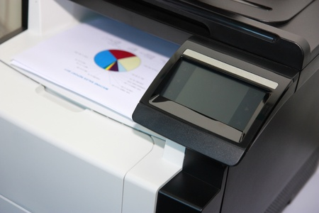 Touchscreen control panel of modern multifunction printer photo