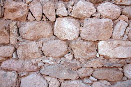 Old red stone wall background horizontal shot