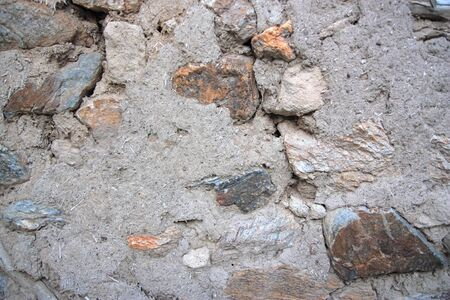 Old stone and mud wall background horizontal