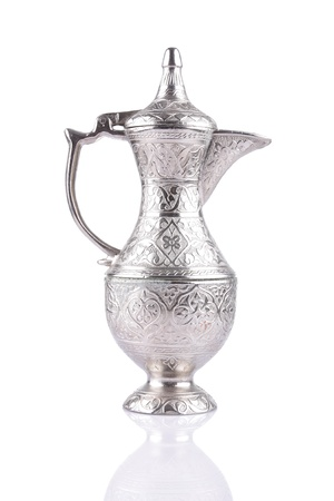 Antique silver pitcher isolated on a white background Stock Photo