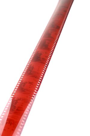 Old camera film strip diegonal over a white background