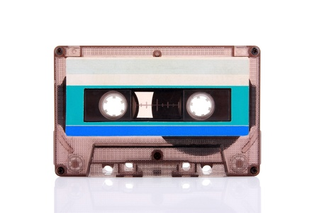 Compact Cassette isolated on white with blank blue label. Including clipping path.