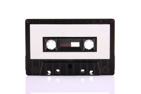 90s: Compact Cassette isolated on white with blank white label. Including clipping path.