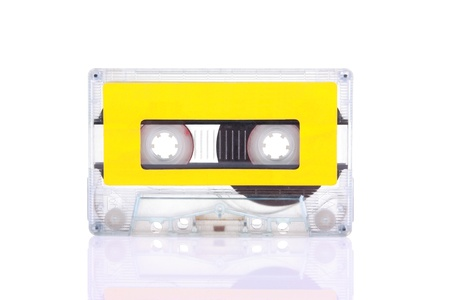 Compact Cassette isolated on white with blank yellow label. Including clipping path.