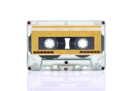 Compact Cassette isolated on white with blank gold color label  Including clipping path  Stock Photo
