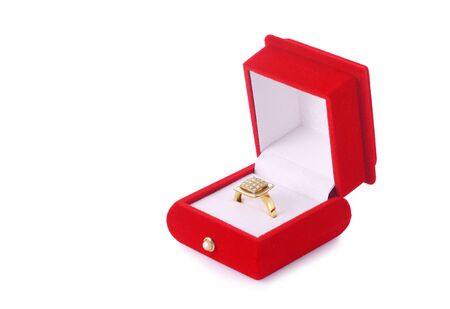 Golden ring in a red box isolated on white background Stock Photo