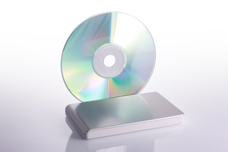 recordable media: External hard disk and blank dvd on white background with reflection  Including clipping path  Stock Photo