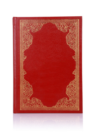Old red book with gold color ornament on cover isolated on white