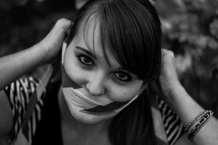 She shook with warning tape face down on the forest background monochrome