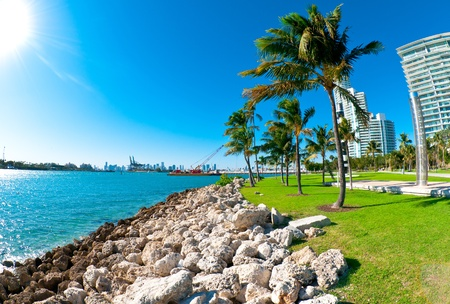 View of waterway used to enter Miami Seaport with city in the background and recreational park at the side Editorial