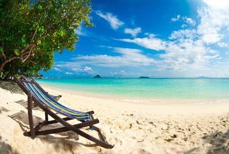 Beach chair on perfect tropical sand beach, Phi Phi Island, Thailand Stock Photo
